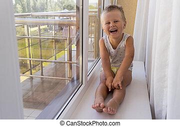 Little boy on the window