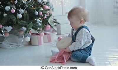 little boy opening a little gift