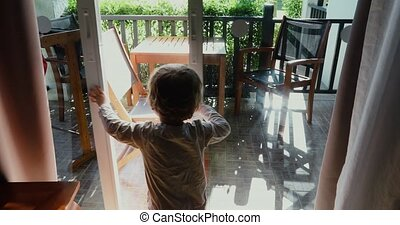 Little boy opening door in the house
