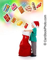 Little boy opening Santa bag with wonderful presents