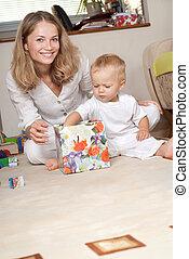 Little boy opens present box