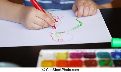 Little boy paints - Hands of painting baby with brush...