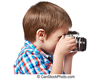 Little boy photographer shooting with SLR camera isolated