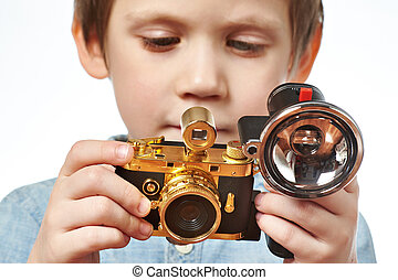 Little boy photographer with retro camera