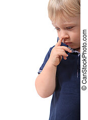 Little boy picking his nose