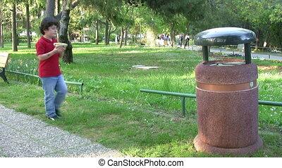 Little boy Picking Up Litter
