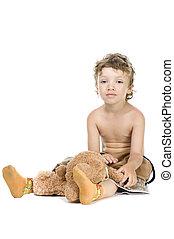 little boy play toy bear on white