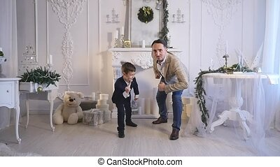Little boy play with her dad . Christmas theme