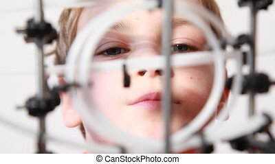 Little boy play with plastic marble run, closeup view