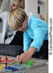 Little boy playing a board game