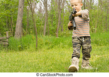Little boy playing at being a soldier