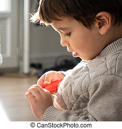 Little boy playing at home