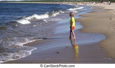 little boy playing at the beach - cute little boy playing at...