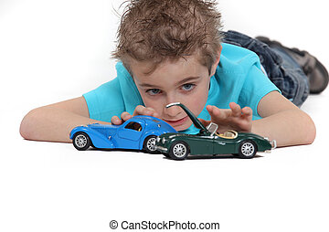little boy playing car