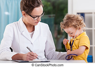 Little boy playing doctor during medical visit