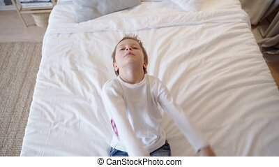 Little Boy Playing, Falls Asleep on Bed Before Bedtime. -...