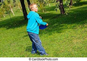 Little boy playing frisbee