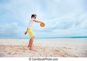Little boy playing frisbee