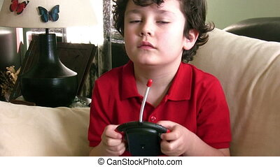 Little boy playing game