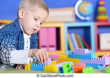little boy playing in room