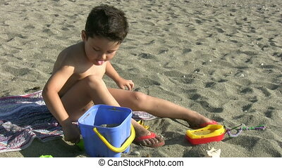 Little boy playing in the beach