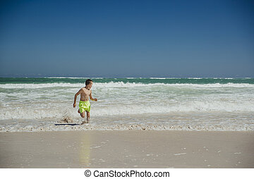 Little Boy Playing in the Sea