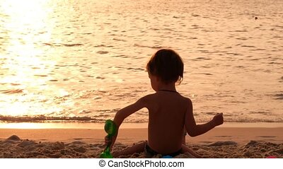 Little boy playing on beach