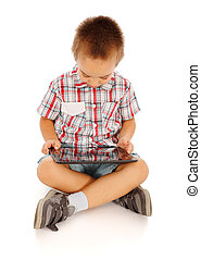 Little boy playing on tablet pc