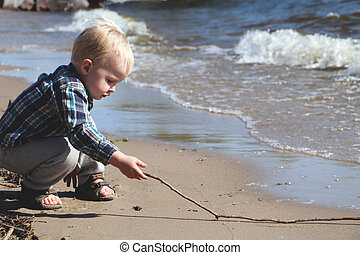 Little boy playing on the beach