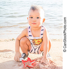 Little boy playing on the beach-WB