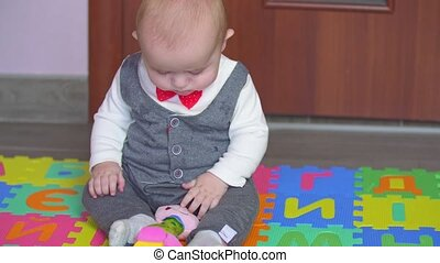 little boy playing on the rug