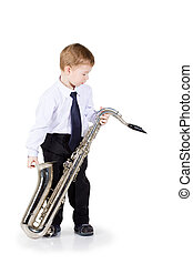 Little boy playing on the saxophone