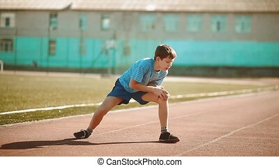 little boy playing sports in a stadium a healthy lifestyle....