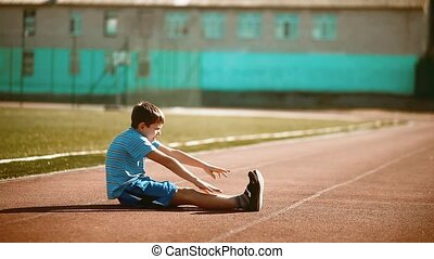 little boy playing sports in a stadium healthy lifestyle....