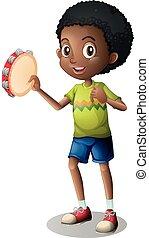 Little boy playing tambourine
