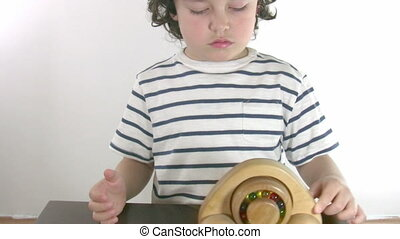 Little boy playing toy