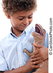 Little boy playing with a dinosaur