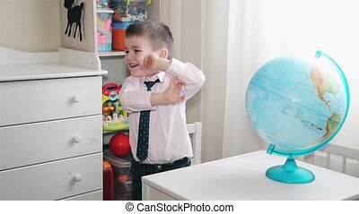 Little boy playing with a globe HD 1020x1080p