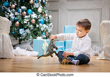 Little boy playing with a toy