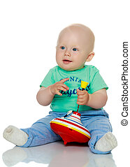 Little boy playing with a whirligig. Isolated on white...