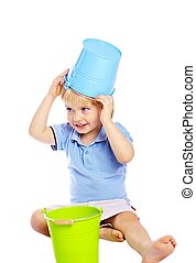 Little boy playing with bucket