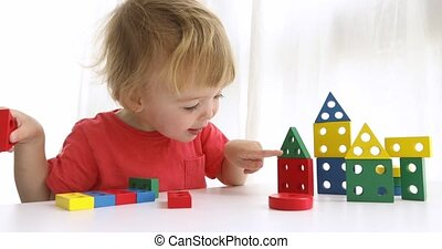 Little boy playing with colorful block