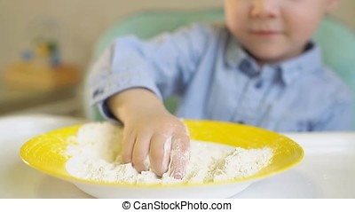 Little Boy Playing With Flour in The Kitchen, Slow Motion