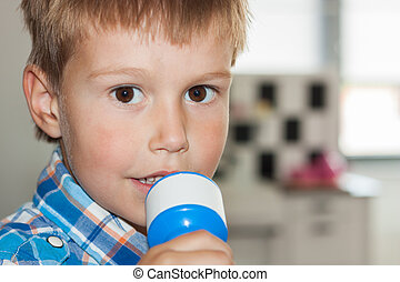 Littly Dutch boy singing and smiling in the toy microphone