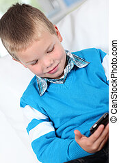 Little boy playing with smartphone