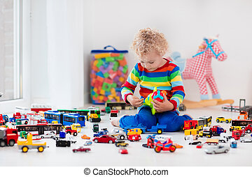 Little boy playing with toy cars