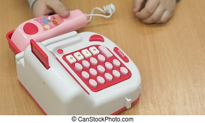 Little boy playing with toy phone indoors