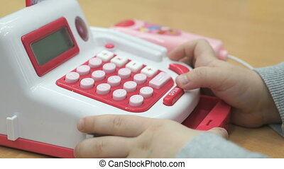 Little boy playing with toy phone indoors - Close up of...