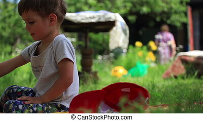 Little boy playing with toys at a g