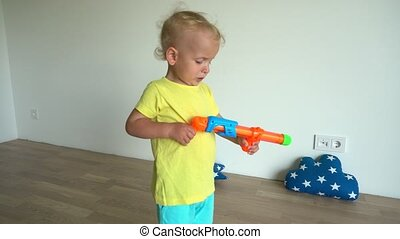Little boy playing with water gun at home. Gimbal stabilizer movement motion